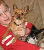 - Garrett and his three dogs Maximus, Tia, and Willow