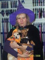 - Rose holding her two babies on Halloween day. Rascal (on the left) in his pumpkin outfit, and Destiny (on the right)in her witches outfit.